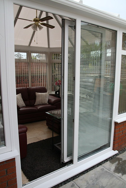 White victorian conservatory with sliding patio door for Conservatory sliding doors