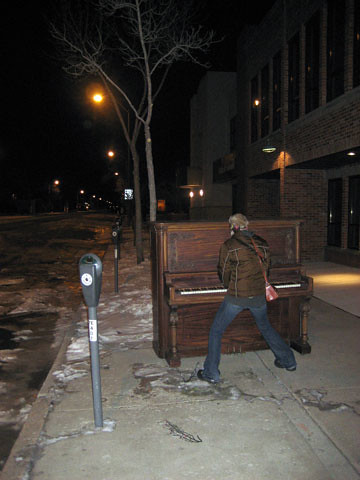 Michael writing music on empty streets in Colorado, inspired by Erin throughout the night.