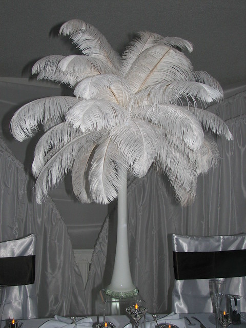 This ostrich feather wedding centerpiece idea is from