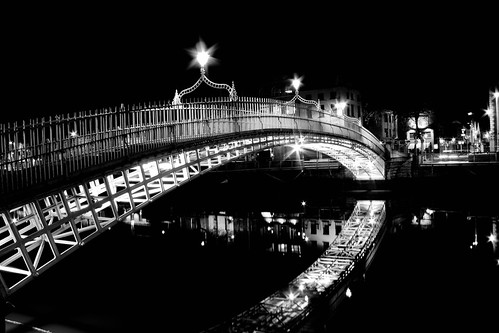 Dublin's Haypenny Bridge over the River Liffey at night in Black and White