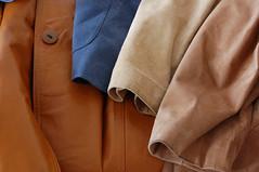 collar(0.0), pocket(0.0), textile(1.0), brown(1.0), clothing(1.0), leather(1.0), khaki(1.0), outerwear(1.0), tan(1.0), coat(1.0),