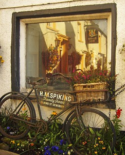 Old bike and window reflection in Cartmel