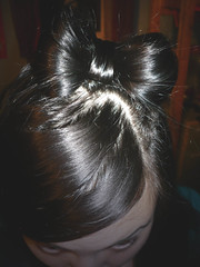 bun(0.0), head(0.0), ear(0.0), brown hair(0.0), hair coloring(0.0), black hair(1.0), face(1.0), hairstyle(1.0), chignon(1.0), brown(1.0), hair(1.0), black(1.0), eye(1.0),