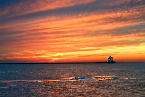 sunset sky orange sun lighthouse lake color ice water clouds fire pier skies lakeerie lorain lorainohio aplusphoto milelongpier