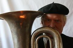 sousaphone(0.0), sculpture(0.0), horn(0.0), horn(0.0), tuba(1.0), head(1.0), brass instrument(1.0), wind instrument(1.0),