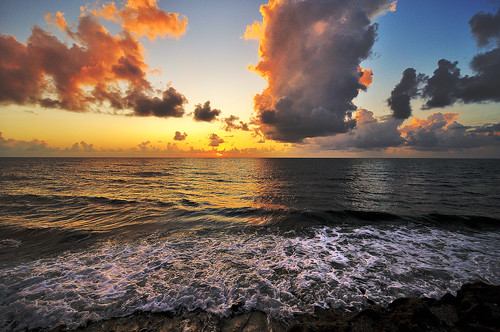 ocean light sunrise rocks break florida blowing shore jupiter lanscape