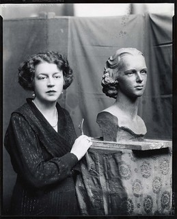 Margaret French Cresson, American sculptor, 1889-1973, standing beside bust of Nathalie Osborn