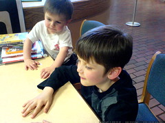 nick applies for his first library card as his littl…