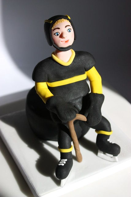 Cake topper - fondant ice hockey player with a walking stick