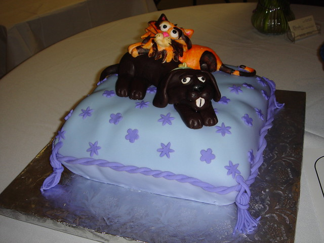 Cat and dog on pillow birthday cake