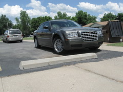 automobile(1.0), automotive exterior(1.0), executive car(1.0), wheel(1.0), vehicle(1.0), rim(1.0), chrysler 300(1.0), chrysler(1.0), bumper(1.0), sedan(1.0), land vehicle(1.0), luxury vehicle(1.0),