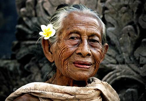 Indonesia, Bali. Portrait of a beautiful elderly balinese lady.