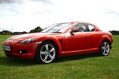 automobile(1.0), automotive exterior(1.0), wheel(1.0), vehicle(1.0), automotive design(1.0), mazda(1.0), rim(1.0), bumper(1.0), land vehicle(1.0), luxury vehicle(1.0), mazda rx-8(1.0), sports car(1.0),