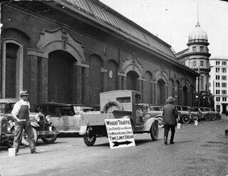Cars parked outside the Harbour Board's shed 11, Jervois Quay, Wellington, 3 March 1932