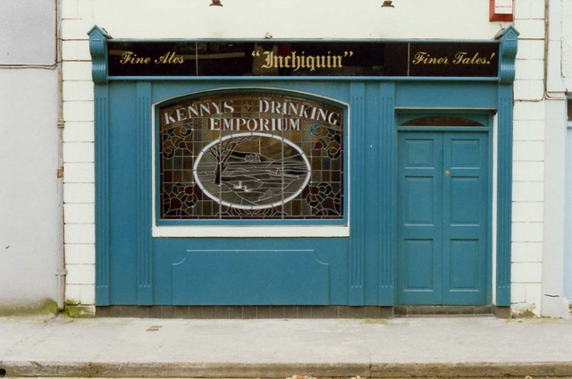 Corofin, Co Clare.  Inchiquin Inn, Kenny's Drinking Emporium stained glass, Apr 1989