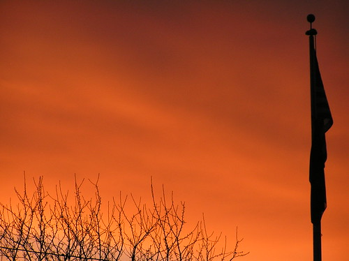 sunset orange sun tree clouds oregon flag branches vivid flagpole setting treebranches lagrande lagrandeoregon easternoregon lagrandeor