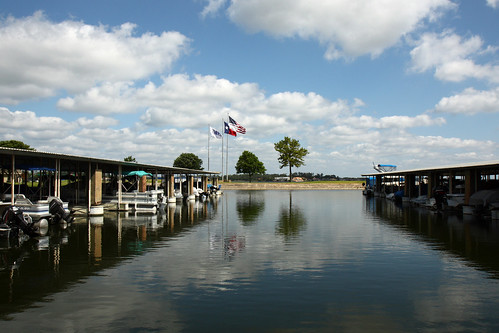 sky lake reflection tree water clouds marina reflections boats boat texas flags breakwater conroe canonefs1755mmf28isusm waldenmarina