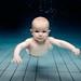 Baby swim by Eythor