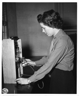 Margaret V. Dunham, standing at bank of instruments