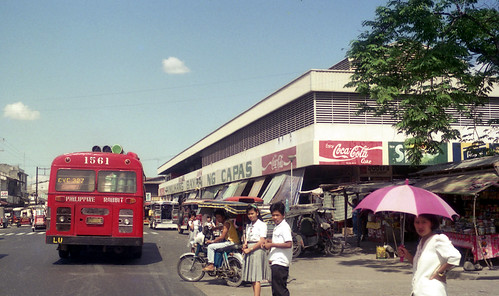 Philippine Rabbit Bus Co Isuzu CVC-327 (fleet No 1561) in the main street of Capas, Tarlac, Philippines.