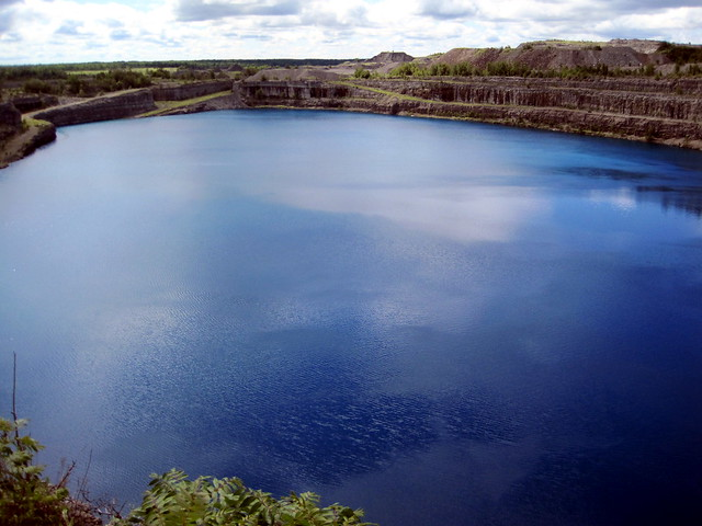 Lake formed by old open pit iron mine