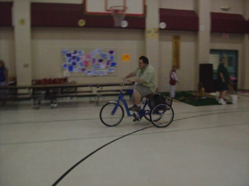 Jonathan and Micah try out new three wheeled bike
