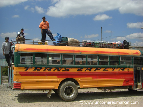 Men on Top of Chicken Bus - Xela, Guatemala
