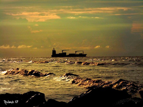 sunset brown landscape gold coast boat rocks waves ship guyana atlanticocean