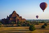 Balloon over Dhammayangyi temple at sunrise,  Bagan, Myanmar by lkunl