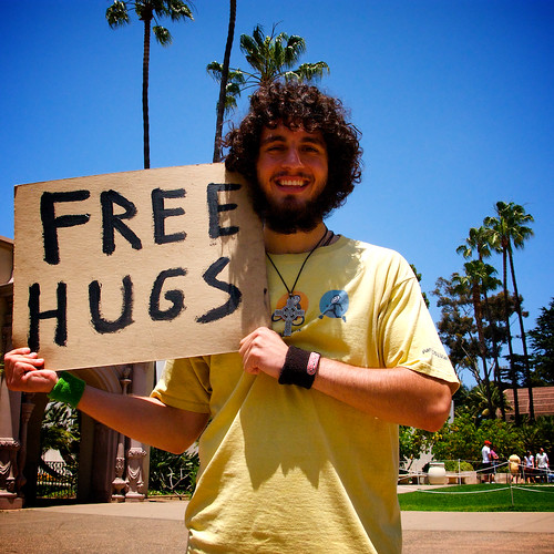 man with free hugs sign