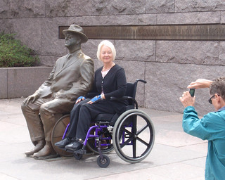 Woman in wheelchair with old friend
