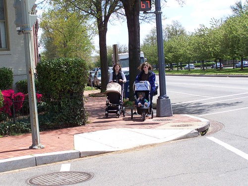 Two women with baby carriages, Pennsylvania Avenue and 9th Street SE