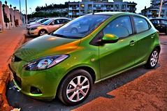 automobile(1.0), vehicle(1.0), compact sport utility vehicle(1.0), mazda(1.0), mazda demio(1.0), city car(1.0), sedan(1.0), land vehicle(1.0),