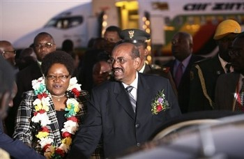 Sudanese President Omer Hassan Al Bashir, right and Zimbabwean Deputy President Joyce Mujuru, left , upon his arrival in the resort town of Victoria Falls in Zimbabwe, Saturday, June 6, 2009. (AP) by Pan-African News Wire File Photos