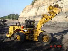 asphalt(0.0), soil(1.0), yellow(1.0), vehicle(1.0), mining(1.0), off-roading(1.0), construction equipment(1.0), bulldozer(1.0),