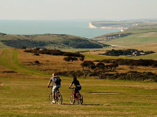 sea people cliff bike bicycle person sussex nationalpark view cycle eastbourne seaford valerie southdowns beachyhead earthday birlinggap naturesfinest april09 canoneos400d pearceval 15challengeswinner