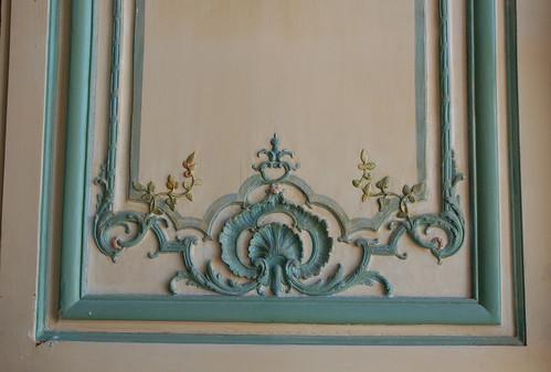 Turquoise and cream woodwork design on interior door – Versailles