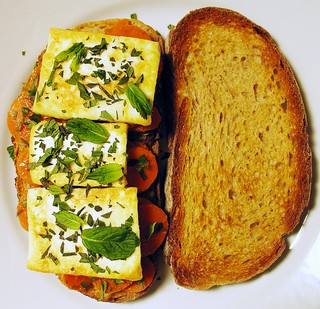 sandwich with spicy carrots and halloumi cheese