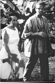 Malcolm X of the Muslim Mosque, Inc. and Shirley Graham DuBois, Director of Ghana National Television, at her villa in Accra, Ghana during Malcolm's visit in May 1964. DuBois had thrown a reception in his honor. by Pan-African News Wire File Photos