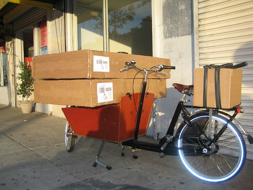Reverse Angle of Two Boxed Bikes on a Bakfiets