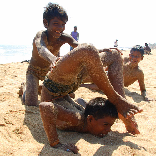 Kids doing yoga on the beach