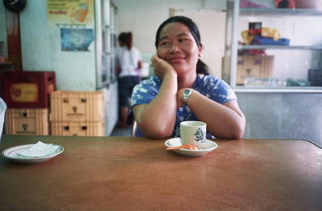 Pudu : A smiley Burmese lady having her breakfast