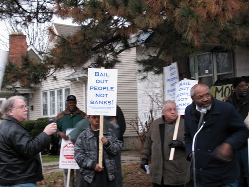 Abayomi Azikiwe covering the rally outside the home of Anthony King, with Jerry Goldberg in background, on Detroit's west side. King was evicted by US Bankcorp. The Moratorium Now! Coalition came to King's defense. (Photo: Alan Pollock) by Pan-African News Wire File Photos