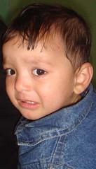 infant(0.0), brown hair(0.0), child(1.0), nose(1.0), chin(1.0), face(1.0), hairstyle(1.0), skin(1.0), lip(1.0), head(1.0), hair(1.0), ear(1.0), cheek(1.0), close-up(1.0), eyebrow(1.0), forehead(1.0), person(1.0), boy(1.0), toddler(1.0), eye(1.0), organ(1.0),