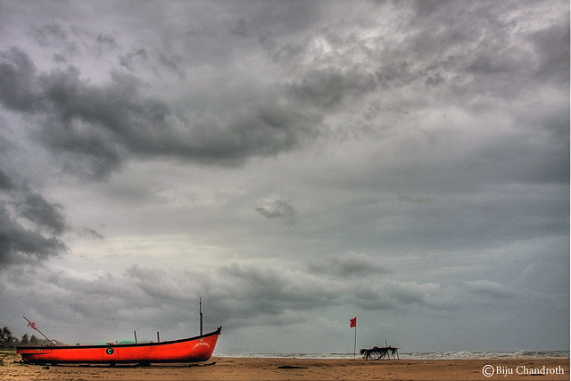 Red against the daunting sky::Bogmallo Beach,Goa