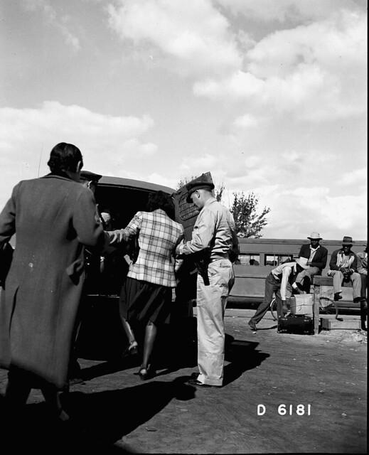 Patrol Men Putting Woman in Paddy Wagon