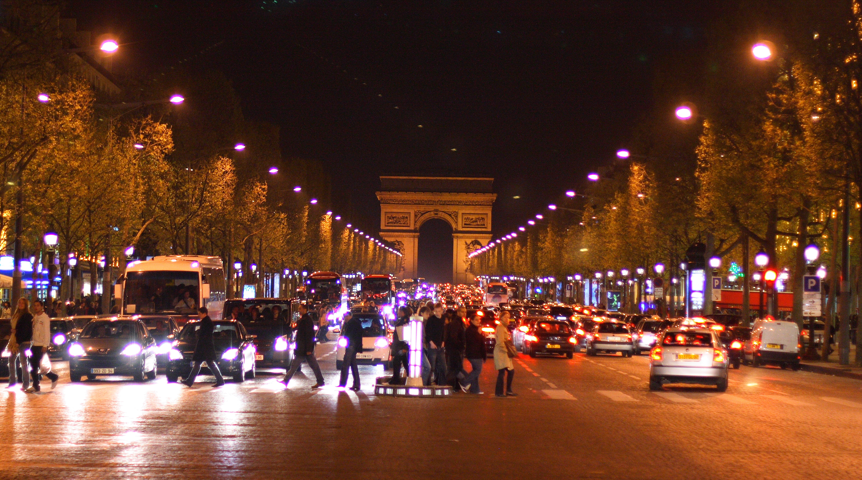 Experience the spectacular Champs Elysees by night