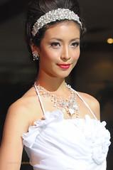veil(0.0), bridal veil(0.0), bride(1.0), bridal clothing(1.0), hairstyle(1.0), model(1.0), clothing(1.0), woman(1.0), fashion(1.0), female(1.0), photo shoot(1.0), headpiece(1.0), wedding dress(1.0), beauty(1.0), dress(1.0),
