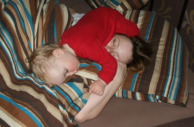 Anna sleeping on her mum