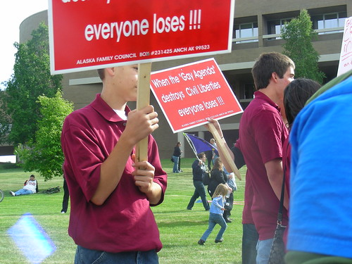 Kids from Aurora, Colorado on a youth mission to Anchorage being bused to the Loussac by ABT to wave signs printed by Jim Minnery's Alaska Family Council during public hearings on AO-64, the Anchorage Equal Rights Ordinance, in 2009.